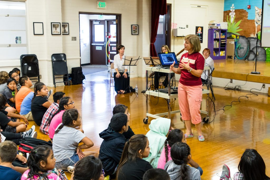 Paula Fowler, Director of Education at Utah Symphony | Utah Opera, teaching students at Bluff Elementary.