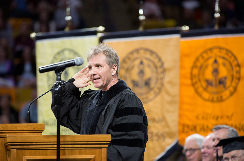 Thierry Fischer at podium for Utah State University Commencement Speech