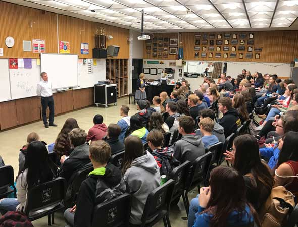 Thierry Fischer speaking at Cottonwood High School