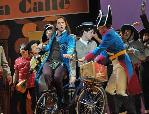 """Opera Philadelphia production of The Barber of Seville. Figaro (Jonathan Beyer) makes his entrance with the famous aria """"Largo al factotum"""". Photos by Kelly & Massa."""